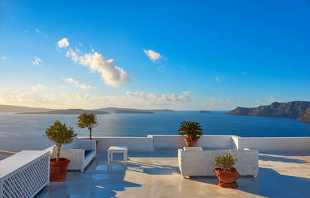 A view of beautiful sea and caldera with luxury roof terrace, typical white architecture of Santorini island, Greece Stock Photo