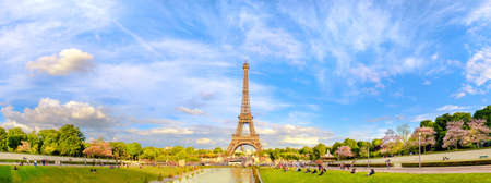 PARIS, FRANCE - MAY 14, 2017: Panoramic image of Eiffel tower on the bright sunny afternoon taken from fountains of Trocadero. This image is toned.