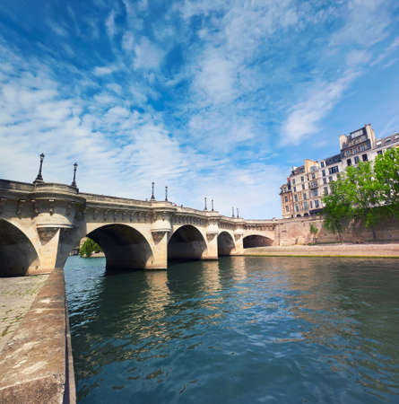 Pont Neuf bridge on Seine river in Paris, France, on a bright sunny day, panoramic image. Stock Photo