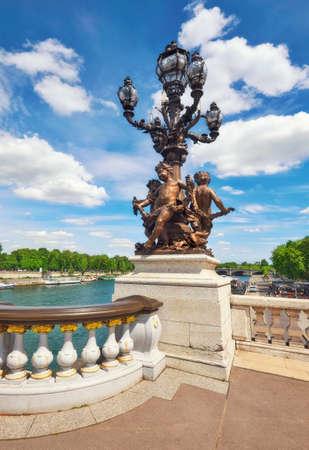 cherubs: Vintage chandelier with dancing cherubs sculpture on Pont Alexandre III in Paris, France Stock Photo