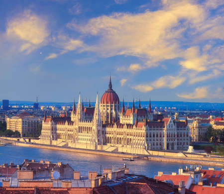 Evening sun on the facade of the Parliament building across Danube river, Budapest, Hungary. Stock Photo