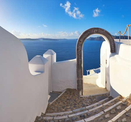 Romantic Santorini Island In Greece: Staircase Through The Arch Leading To  Majestic View Over Caldera