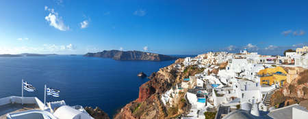 Panoramic image if Oia village, Santorini island, Greece, and famous volcanic caldera on a bright day