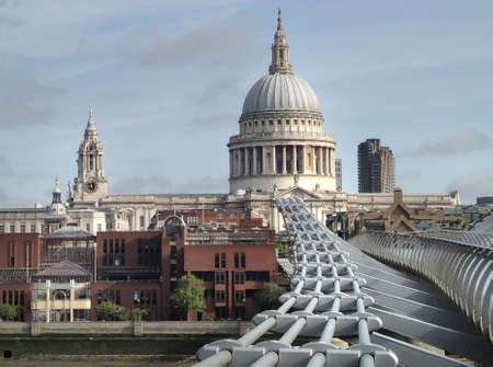 London, closeup on Millennium bridge and St. Paul on a  bright day with clouds