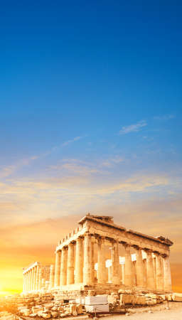 Acropolis in Athens, Greece, Parthenon temple on a sunset. Space for your text.