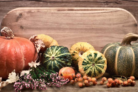 Autumn background with Fall dry decorations on wood. Side view, toned image, focus on the decorations. Space for your text Stock Photo