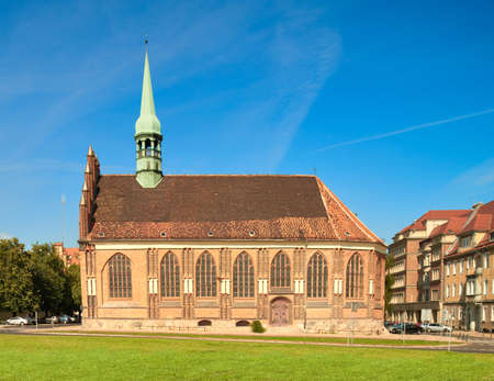 townhouses: St. Peter and Paul church in Stettin, Poland, on a bright day in Summer. Stock Photo