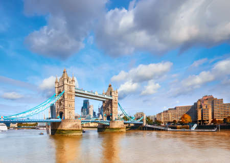 Tower Bridge in London on a bright sunny day under gorgeous sky with clouds