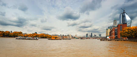 London, panoramic view over Thames river from bridge on a gloomy overcast day in Fall. This image is toned. Stock Photo