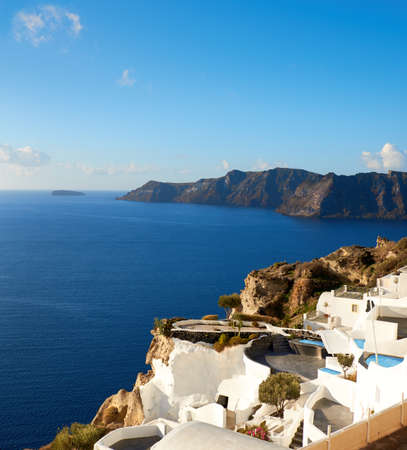 Beautiful Santorini in Greece - apartments and houses overlooking volcanic caldera in Oia village, panoramic image