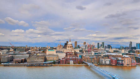 London, panoramic aerial view over Thames river with Millenium bridge, St. Paul and London skyline. Toned image. Stock Photo