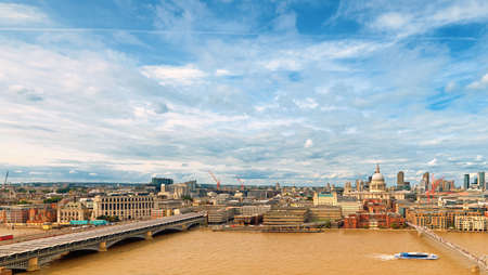 London, panoramic aerial view with Blackfriars bridge, Millenium bridge, St. Paul and London skyline on a bright day with clouds. Stock Photo