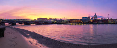Panoramic view of Thames river on a sunset with Blackfriars bridge and St. Pauls cathedral in London, United Kingdom