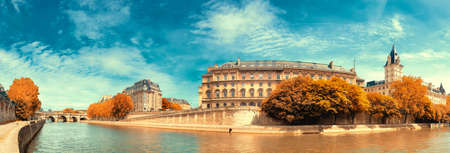 Panoramic image of Ile de la Cite in Autumn, filtered image. Seine riverside, with Pont Neuf on the left.