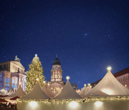 Iluminated Christmas market Gandarmenmarkt in Berlin, Germany, at night. Panoramic image, text space