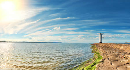 Panoramic image of a seaside by lighthouse in Swinoujscie, a port in Poland on the Baltic Sea. 스톡 콘텐츠