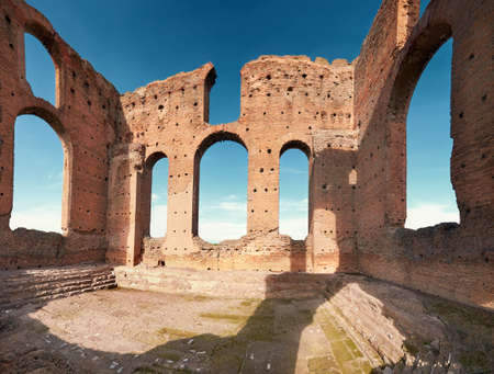 Ruins of Villa dei Quintili,a landmark upon Appia Way leading to Rome in Italy, panoramic image. Stock Photo
