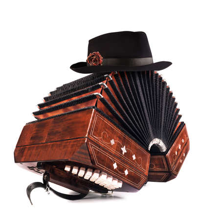 Bandoneon, tango instrument with a male hat on top. Argentine tango element isolated on white background.