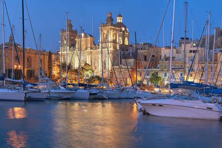 Sailing boats on Senglea marina in Grand Bay, Valetta, Malta in the evening Stock Photo