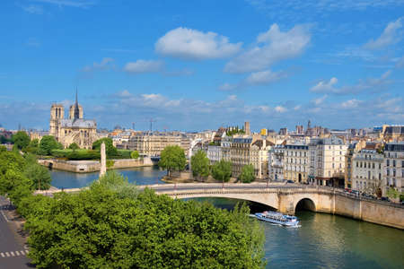 Notre-Dame cathedral in Paris in Spring, an aerial view of islands on the river Seine