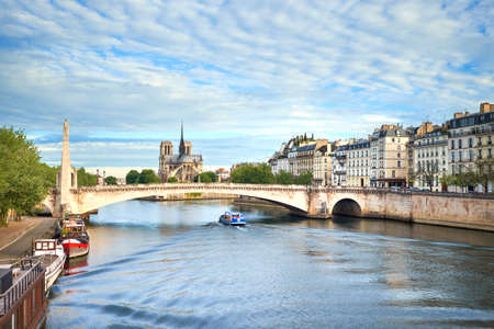 Paris, view of river Seine with Notre-Dame cathedral on a bright day in spring Stock Photo