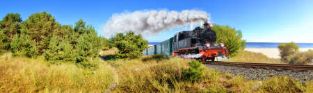 Historical German steam train in spring, Rugen, Germany, panoramic image