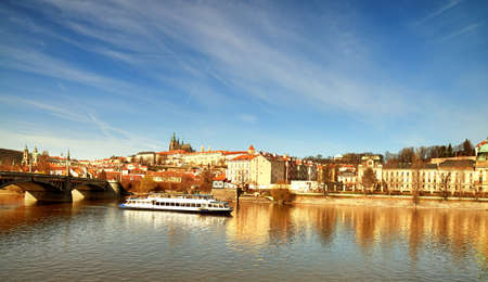 iew on St. Vitus Cathedral and Prague Castle across Vltava river on a bright Autumn day. This image is toned. Editorial