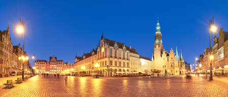 Wroclaw city in Poland, Eastern Europe. Market square and Town Hall at night. Panoramic image.