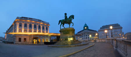 Panoramic night view of equestrian statue of Archduke Albert in front of the Albertina Museum in Vienna, Austria