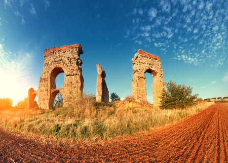 Ruins of the ancient aqueduct near Villa Quintili on Appia Way in Rome, Italy