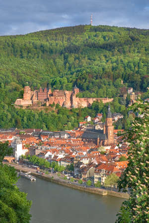 Heidelberg and ruins of Heidelberg Castle (Heidelberger Schloss) in a beautiful day in Spring. Picture was taken in Heidelberg, Germany, from the hill across the river. Stock Photo