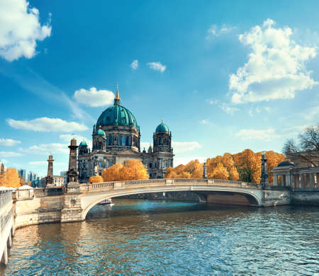 Berlin Cathedral with a bridge over Spree river in Autumn, panoramic toned image