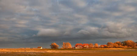 Hiddensee island in the Baltic sea in North Germany. Panoramic image with traditional houses on a sunset. Stok Fotoğraf