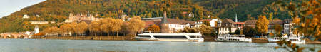 Panoramic view of Heidelberg and Neckar river in Autumn on a bright sunny day