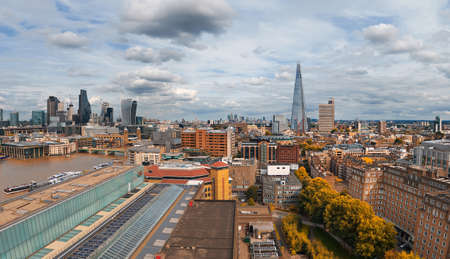 Panoramic aerial view with the Shard, skyscrapers of the City of London and London skyline on a gloomy overcast day in Autumn, toned image