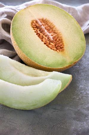 Sliced Cantaloupe melone on dark textured background