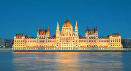 Parliament building in Budapest, Hungary in evening illumination from across the river Danube Reklamní fotografie