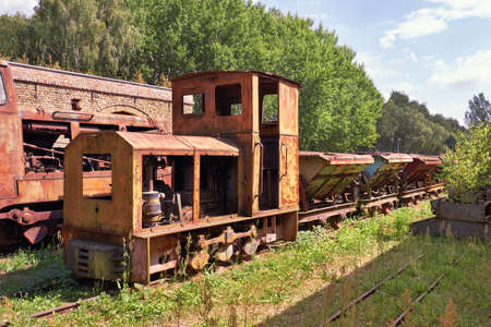 Derelict and rusting steam train and coal vagons at the historic Brick factory (Ziegeleipark in German) in Mildenberg near Berlin, Germany