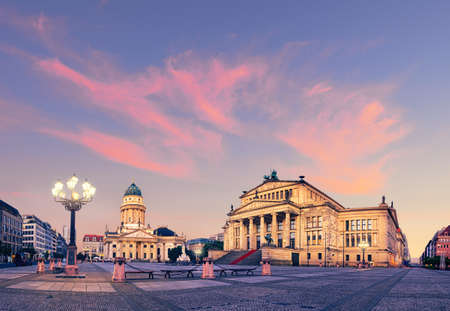 Panoramic image of Gendarmenmarkt square in Berlin with German church and Concert Hall on a sunset. This picture is toned
