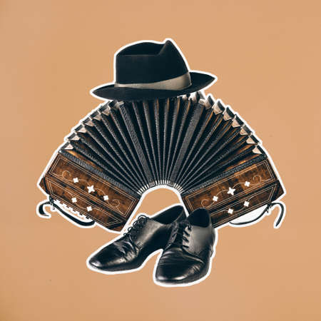 Bandoneon, tango instrument withpair of male dancing shoes and a hat on top with white border on square orange paper. Retro Argentine tango collage in magazine style