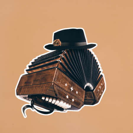 Bandoneon, tango instrument with a male hat on top with white border on square orange paper. Retro Argentine tango collage in magazine style