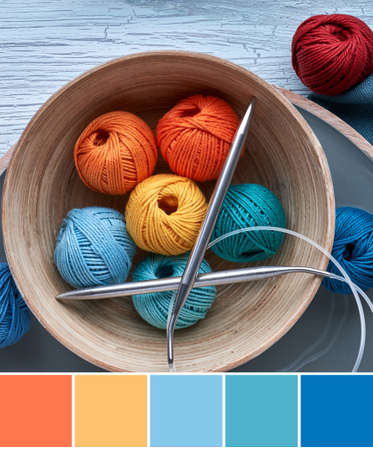Color matching palette from picture of yarn balls and needles on textured wood