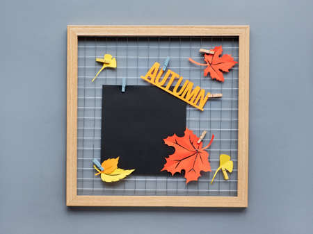 Photo grid board with red and orange paper Autumn leaves and text