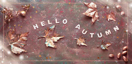 Autumn flat lay with painted golden leaves and text Hello Autumn on dark green textured bacgkrdound. Panoramic toned image, banner composition with frame. Stok Fotoğraf