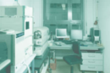 BLurred laboratory interior, scientific background with copy-space. Modern research facility room out of focus. This blurred image toned in tile or light cyan color Stock fotó