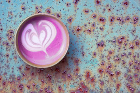 Beetroot super latte in disposable craft paper cup, top view on aged metal rusty surface Stok Fotoğraf