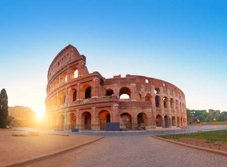 Colosseum (Coliseum) in Rome, Italy, on a sunrise, panoramic image with rising Sun Banco de Imagens