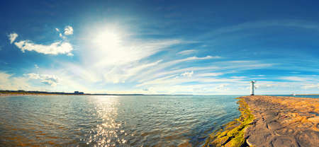 Panoramic image of a seaside by lighthouse in Swinoujscie, a port in Poland on the Baltic Sea. Stock Photo