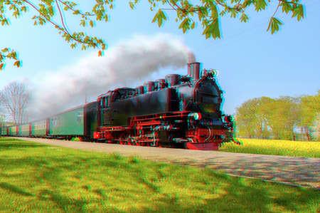 Historische Duitse stoomtrein in de lente, Rugen, Duitsland, 3d anaglyph-effect Stockfoto