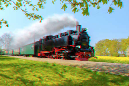 Historischer deutscher Dampfzug im Frühjahr, Rügen, Deutschland, 3D-Anaglypheneffekt Standard-Bild